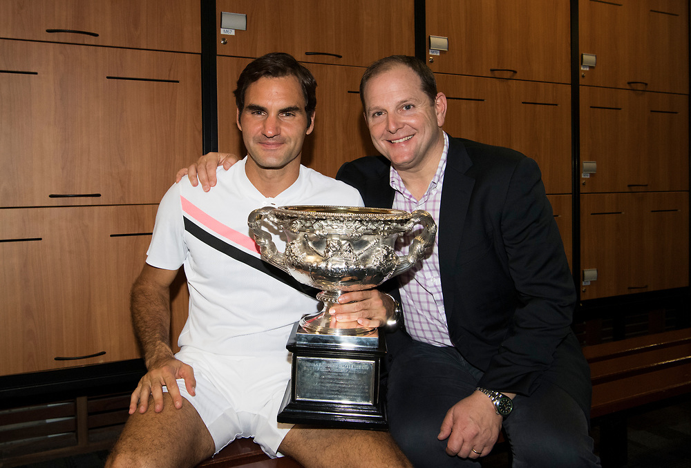Roger Federer of Switzerland in the locker room with the Norman Brooks Challenger Cup after winning the 2018 Australian Open on day 14 at Rod Laver Arena in Melbourne, Australia on Sunday afternoon January 28, 2018.<br /> (Ben Solomon/Tennis Australia)