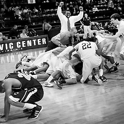 Kyle Green | The Roanoke Times<br /> 3/3/2012 Christiansburg High School team members swarm Jordan Price after he hit the winning shot at the buzzer over Amherst County High School during the Group A Boys Division 4 VHSL 2012 Basketball Championships quarterfinals held at the Salem Civic Center in Salem, Virginia. Christiansburg defeated Amherst County 47-45. Amherst County player AJ Richerson (left, 23) is also pictured.