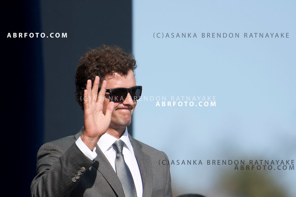 16 November 2011 : International team member Adam Scott from Australia waves to the crowd during the opening ceremony at the Presidents Cup at the Royal Melbourne Golf Club in Melbourne, Australia. .