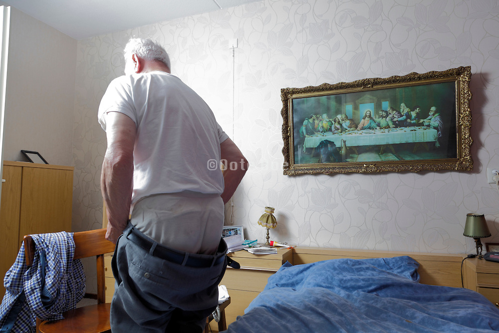 elderly single male person going to bed in a independent living retirement home