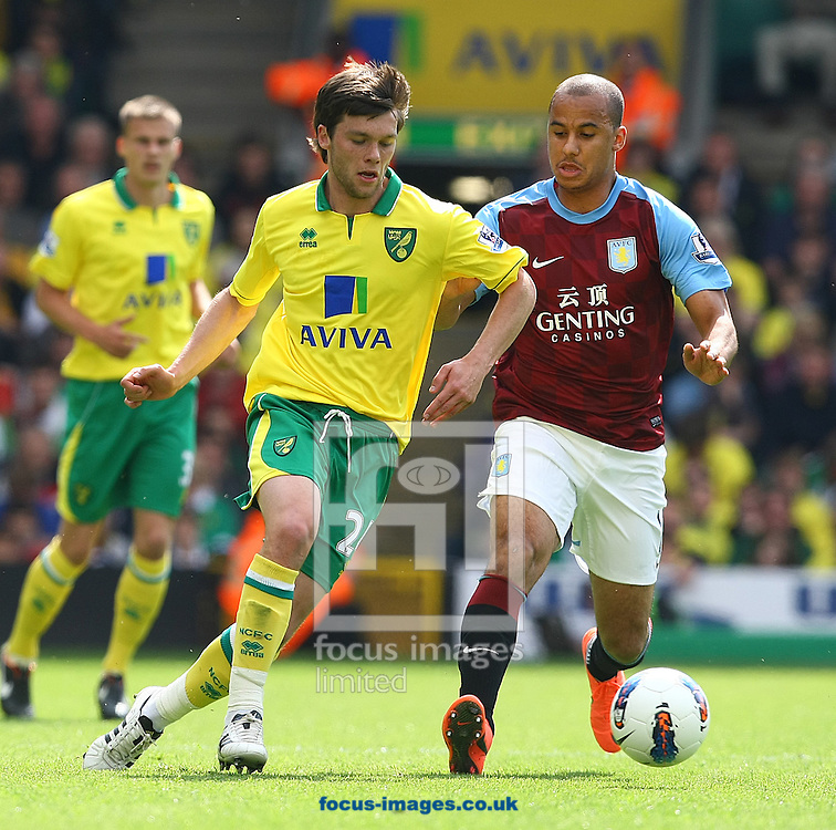 Picture by Paul Chesterton/Focus Images Ltd.  07904 640267.13/05/12.Jonny Howson of Norwich and Gabriel Agbonlahor of Aston Villa in action during the Barclays Premier League match at Carrow Road Stadium, Norwich.