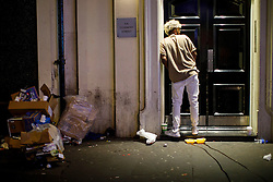 © Licensed to London News Pictures. 01/01/2017. London, UK. A man urinates in public as revellers celebrate the New Year in central London during the first hours of 2017 on January 1. Photo credit: Tolga Akmen/LNP