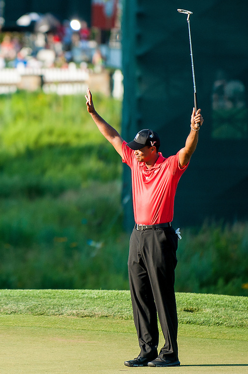 Tiger Woods acknowledges the crowd after sinking the winning putt on the eighteenth hole at Congressional CC during the final round of the AT&T National in Bethesda, MD on Sunday. Woods shot a 2-under par 69 to finish 8 under and win the tournament.