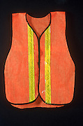 Traffic worker's reflective vest against black surface