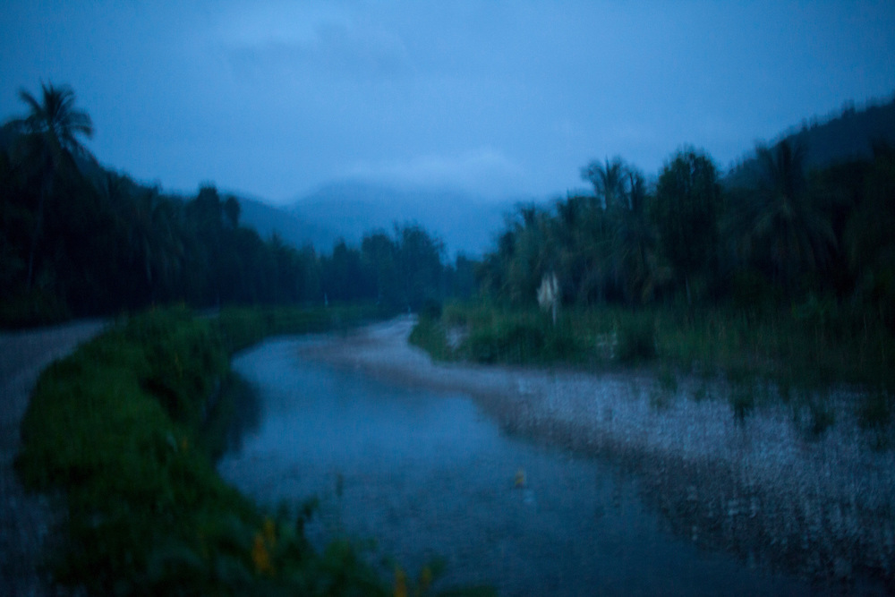 A river flows after sunset on July 15 2010 in Gador, Haiti.