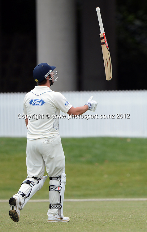 Otago's Hamish Rutherford throws his bat in the air after being dismissed and on his way back to the dressing room. Plunket Shield Cricket, Auckland Aces v Otago Volts at Eden Park Outer Oval. Auckland on Tuesday 4 December 2012. Photo: Andrew Cornaga/Photosport.co.nz