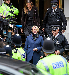© Licensed to London News Pictures. 14/11/2016. London, UK. Swedish officials, including INGRID ISGREN (blonde hair, front) leave the Ecuadorian Embassy in London during a lunch break in questioning of WikiLeaks editor-in-chief, Julian Assange. Assange, who has been living at the embassy for over four years, is wanted for questioning over accusations of rape in Stockholm in 2010.  Photo credit: Ben Cawthra/LNP
