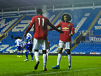 Football - 2019 / 2020 Premier League 2 (Under-23s) Division Two - Reading vs. Manchester United<br /> <br /> Manchester United's Aliou Traore celebrates scoring his side's second goal with Tahith Chong, at the Madejski Stadium.<br /> <br /> COLORSPORT/ASHLEY WESTERN