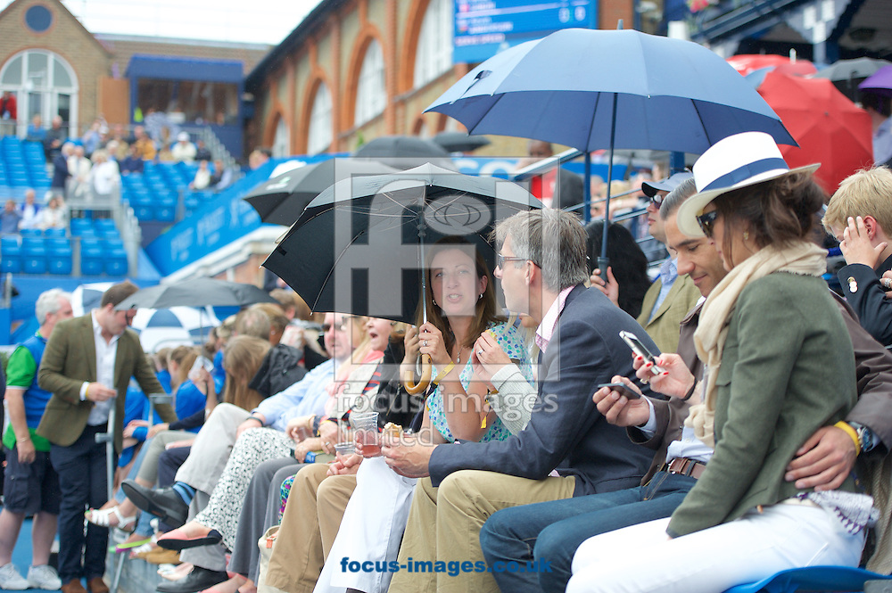 The umbrellas go up before the players can finish their warm up for the match between Kevin Anderson of South Africa and Giles Simon of France in Aegon Championships at the Queen's Club, West Kensington<br /> Picture by Alan Stanford/Focus Images Ltd +44 7915 056117<br /> 20/06/2015