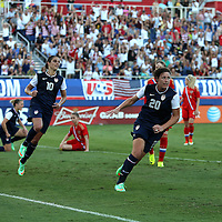 U.S. forward Abby Wambach (20) celebrates after scoring a goal during an international friendly soccer match between the United States Women's National soccer team and the Russia National soccer team at FAU Stadium on Saturday, February 8, in Boca Raton, Florida. (AP Photo/Alex Menendez)