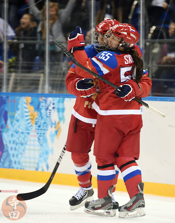 Feb 16, 2014; Sochi, RUSSIA; Russia forward Galina Skiba (55) celebrates with teammates after scoring a goal against Japan in a women's ice hockey classifications round game during the Sochi 2014 Olympic Winter Games at Shayba Arena.