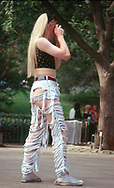 Woman in ripped pants in Central Park