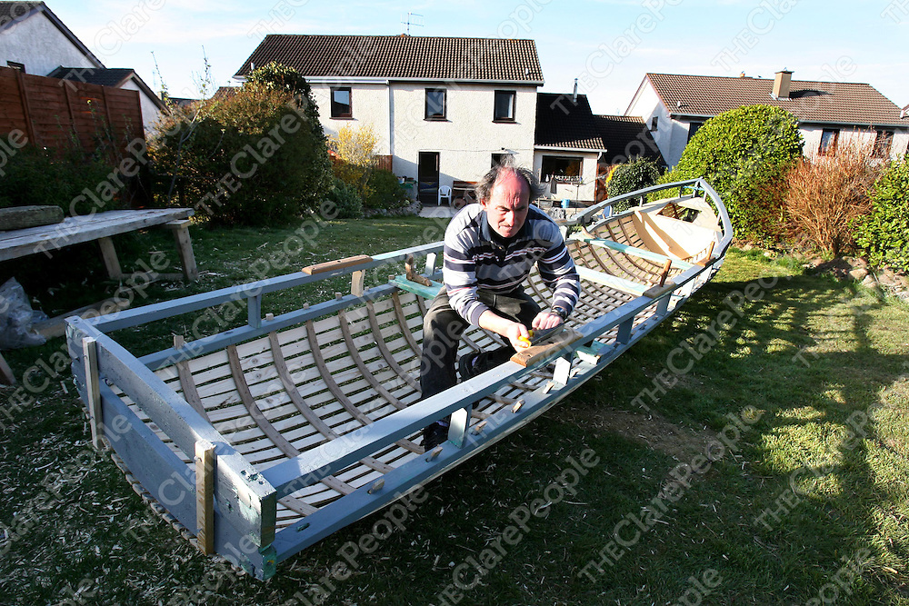 Michael Faherty at work on his Currach in Pinegrove ,Ennis .<br /><br />Photograph by Eamon Ward