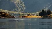 Lonely house at Brakøya, Raftsundet, Vestrålen, Nordland, Norway on a warm summer's day.