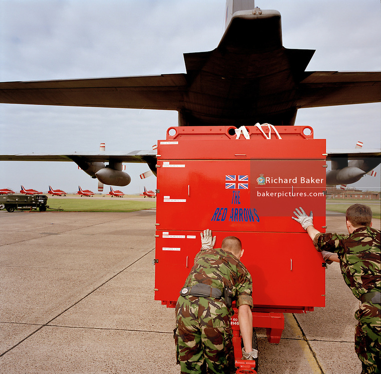 Engineering ground staff of the Red Arrows, Britain's RAF aerobatic team, load flight spares before annual trip to Cyprus.