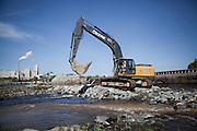 Workers begin the removal of the Great Works Dam from the Penobscot River in Maine on Monday, June 11, 2012.  Craig Dilger for The New York Times