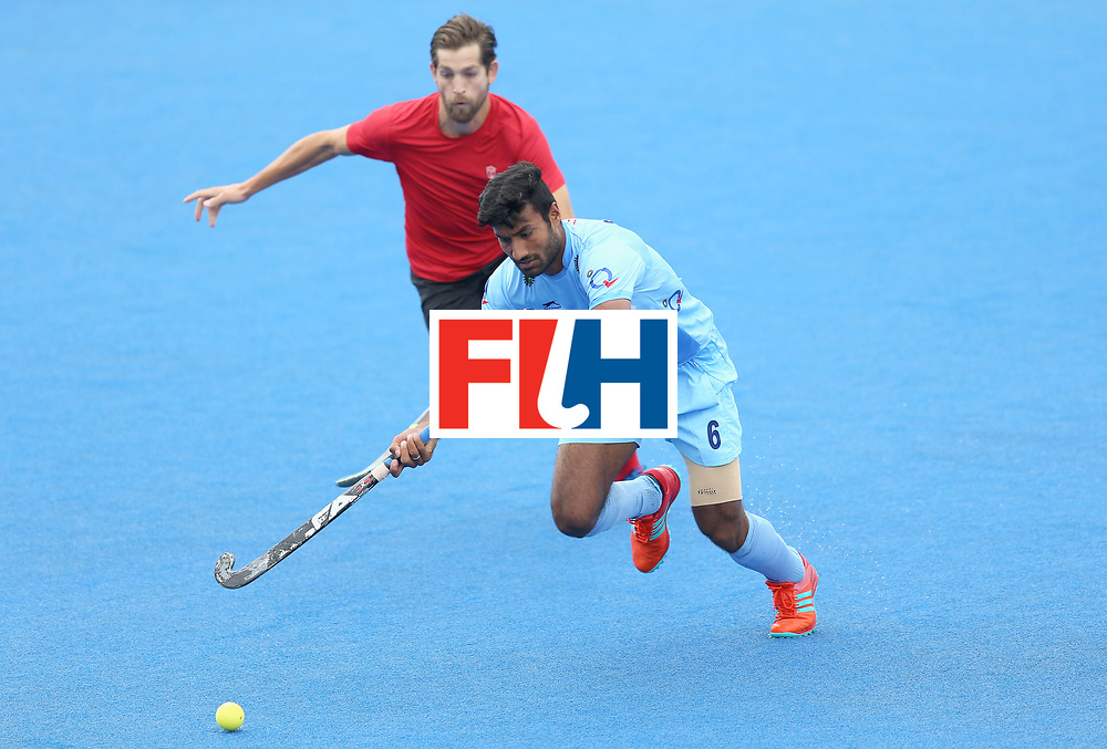 LONDON, ENGLAND - JUNE 25: Surender Kumar of India is put under pressure by Iain Smythe of Canada during the 5th/6th place match between India and Canada on day nine of the Hero Hockey World League Semi-Final at Lee Valley Hockey and Tennis Centre on June 25, 2017 in London, England. (Photo by Steve Bardens/Getty Images)