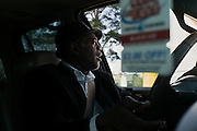 """MONTGOMERY, AL – JANUARY 25, 2016: Michael Harris, 52, pulls into to a McDonald's drive through on a client's lunch errand. In 2011, the downtown Montgomery Greyhound bus station was converted into a museum to honor the freedom riders, who endured a violent attack there in 1961. The replacement bus station, located four miles from downtown, is a prime business opportunity for independent cabbies like Mr. Harris, who make a living serving passengers unwilling to rely on city buses. Many characterize the public bus system in Montgomery as unsafe and unreliable, so wary passengers cough up $2 per mile for trips in Mr. Harris' 2005 Lincoln Navigator, traveling across town for fast food, or sometimes as far as New York City. """"This is my life,"""" Harris said. """"I love driving, and I help people out. It's just in my heart."""""""