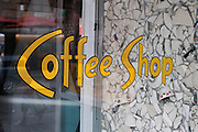 The bright gold lettering on the front window of the Coffee Shop located across from Union Square in Manhattan.