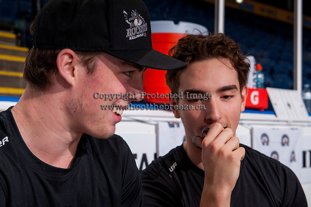 KELOWNA, CANADA - NOVEMBER 14: Kole Lind #16 and Liam Kindree #26 of the Kelowna Rockets sit on the bench after off-ice pre-game warm up against the Edmonton Oil Kings on November 14, 2017 at Prospera Place in Kelowna, British Columbia, Canada.  (Photo by Marissa Baecker/Shoot the Breeze)  *** Local Caption ***