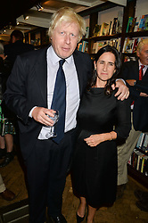 BORIS JOHNSON and his wife MARINA at a party to celebrate the publication of Stanley I Resume by Stanley Johnson at the Daunt Bookshop, Marylebone High Street, London on 23rd September 2014.