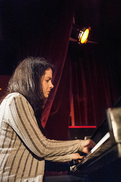 Kris Davis plays piano along with drums with Eric Revis on bass and Andrew Cyrille on drums at the Zinc Bar during the 2013 Winter Jazz Fest in New York City, Friday 11 January, 2013.