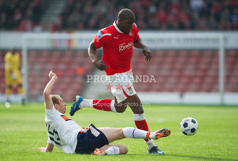 WREXHAM, WALES - Monday, May 7, 2012: Wrexham's Mathias Pogba in action against Luton Town's Jake Howells during the Football Conference Premier Division Promotion Play-Off 2nd Leg at the Racecourse Ground. (Pic by David Rawcliffe/Propaganda)