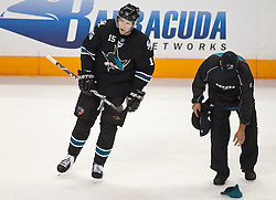 October 8, 2009; San Jose, CA, USA;  A member of the San Jose Sharks staff (right) picks up hats thrown on the ice after right wing Dany Heatley (15) scored his third goal of the game during the third period against the Columbus Blue Jackets at HP Pavilion. San Jose won 6-3. Mandatory Credit: Jason O. Watson / US PRESSWIRE