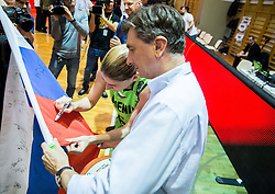 Maja Erkic of Slovenia signing a flag of Borut Pahor, president of Slovenia after the basketball match between Women National Teams of Slovenia and Lithuania in Qualifications of EuroBasket Women 2017, on November 19, 2016 in Gimnazija Celje, Slovenia. Photo by Vid Ponikvar / Sportida