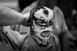 Children get ready for the action in the ring with their wrestling masks during Old School Championship Wrestling Sunday, March 13, 2016 at the Hanahan Sports Complex. Paul Zoeller/Staff