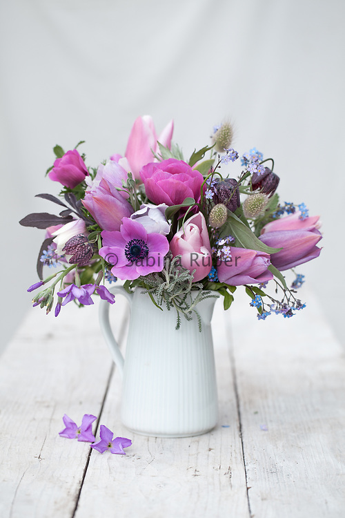 Soft pink and purple Spring flower arrangement with Anemones, Tulips, Fritillaria meleagris and scented stock