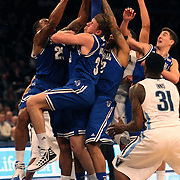 Patrik Auda, (centre), and his Seton Hall team mates combine to pull in a rebound during the Villanova Wildcats Vs Seton Hall Pirates basketball game during the Big East Conference Tournament at Madison Square Garden, New York, USA. 12th March 2014. Photo Tim Clayton