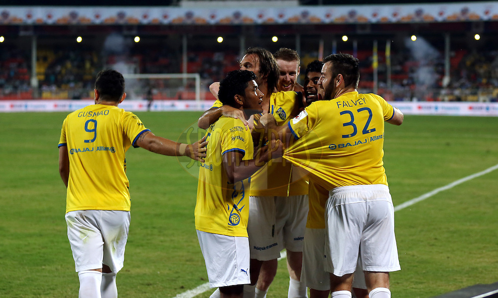 Kerala Blasters FC team celebrate after the goal during match 17 of the Hero Indian Super League between FC Pune City and Kerala Blasters FC held at the Shree Shiv Chhatrapati Sports Complex Stadium, Pune, India on the 30th October 2014.<br /> <br /> Photo by:  Sandeep Shetty/ ISL/ SPORTZPICS