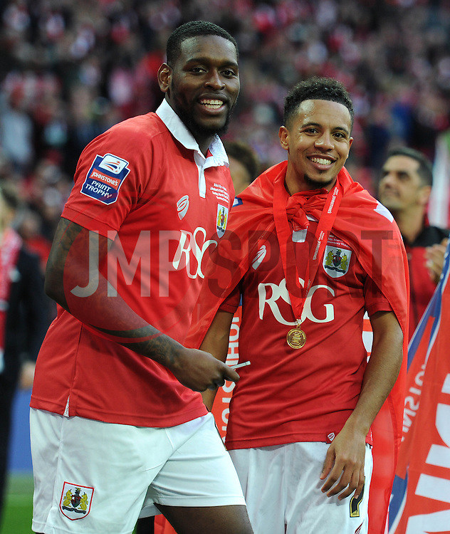 Bristol City's Jay Emmanuel-Thomas and Bristol City's Korey Smith smile as they celebrate winning the Johnstone Paint Trophy against Walsall - Photo mandatory by-line: Dougie Allward/JMP - Mobile: 07966 386802 - 22/03/2015 - SPORT - Football - London - Wembley Stadium - Bristol City v Walsall - Johnstone Paint Trophy Final