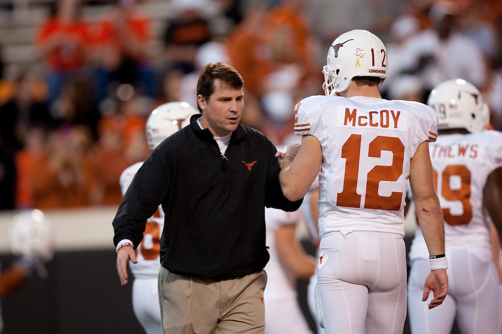Will Muschamp, defensive coordinator, and Colt McCoy, quarterback. Texas Longhorns at Oklahoma State Cowboys. Photographed at Boone Pickens Stadium in Stillwater, Oklahoma on Saturday, October 31, 2009. Photograph ©  2009 Darren Carroll