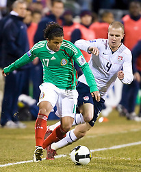 United States midfielder Michael Bradley (4) tries to steal the ball from Mexico forward Giovani dos Santos (17).  The United States men's soccer team defeated the Mexican national team 2-0 in CONCACAF final group qualifying for the 2010 World Cup at Columbus Crew Stadium in Columbus, Ohio on February 11, 2009.