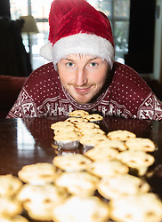 SWTMince: Pod Howard, 27, from Belsize Park in North London is eating nothing but Mince pies in the run up to Christmas as part of a charity fundraising effort. London, December 19 2018.