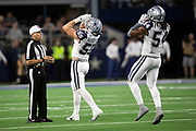 Dallas Cowboys rookie outside linebacker Leighton Vander Esch (55) howls like a wolf as he celebrates with Dallas Cowboys middle linebacker Jaylon Smith (54) as referee Walt Anderson (66) looks on after Vander Esch stuffs a third quarter run for a loss of a yard at the Cowboys 48 yard line during the NFL week 13 regular season football game against the New Orleans Saints on Thursday, Nov. 29, 2018 in Arlington, Tex. The Cowboys won the game 13-10. (©Paul Anthony Spinelli)