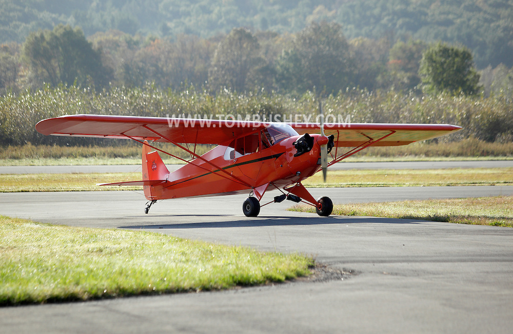 Wurtsboro, New York - A Piper Cub airplane on the runway at Wurtsboro Airport during the annual Fly In - Drive- In Breakfast on Oct. 9, 2011.