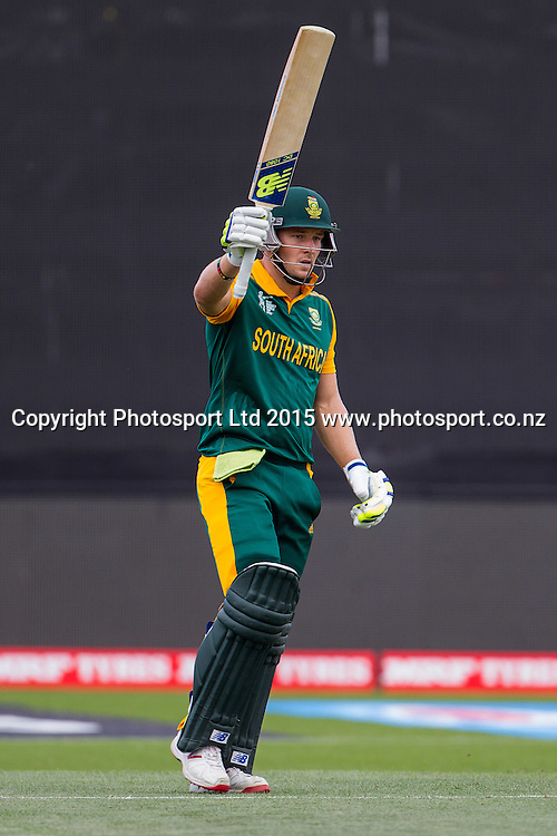 South Africa's David Miller raises hit bat upon reaching his 50 during the ICC Cricket World Cup match - South Africa v Zimbabwe at Seddon Park, Hamilton, New Zealand on Sunday 15 February 2015.  Photo:  Bruce Lim / www.photosport.co.nz