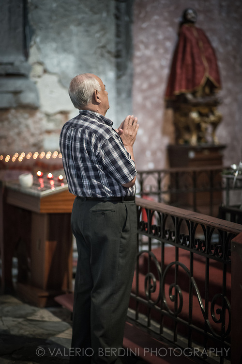 A man prays in Igreja de Sao Domingo, one of the oldest churches in Lisbon. The majority of Portogues are catholics and a large percentage practices.