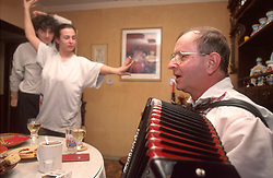 CZECH REPUBLIC MORAVIA BANOV APR98 - Jiri Chovanec (R) plays the accordeon while Lucie Frantova (L) and her friend dance to the tune.  During Easter, folklore dress, music and mutual visits are part of the customary traditional celebrations in Moravia.  jre/Photo by Jiri Rezac<br /> <br /> &copy; Jiri Rezac 1998<br /> <br /> Tel:   +44 (0) 7050 110 417<br /> Email: info@jirirezac.com<br /> Web:   www.jirirezac.com