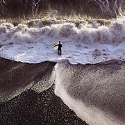A lone surfer inspects the waves at a northern California beach near Crescent City.  The wet suit was necessary because of early April ocean temperatures.