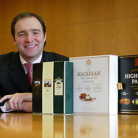 William Ovens with the special edition duty free packs of Famous Grouse Whisky, Macallan Whisky and Highland Park whisky.<br /><br />Picture by Graeme Hart.<br />Copyright Perthshire Picture Agency<br />Tel: 01738 623350  Mobile: 07990 594431