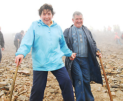 'Helping Hands on Ireland's holy mountain'.Kathleen and Pat Dolan from Corlough Co Cavan making their way down Croagh Patrick on Reek Sunday ...Pic Conor McKeown