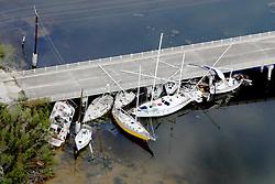 September 14, 2017 - Marathon, Florida, U.S.- Boats are wedged under a bridge in Marathon in the Florida Keys after Hurricane Irma. (Credit Image: © Sun-Sentinel via ZUMA Wire)