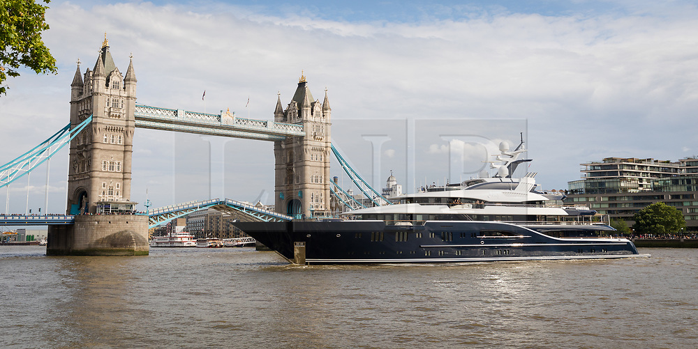 © Licensed to London News Pictures. 09/06/2019. London, UK.  The luxury 279 feet long (85 metre) superyacht Solandge arrives in London on the River Thames this evening seen turning around in front of Tower Bridge and is the first superyacht to visit the pool of London in the capital this year.  Superyacht Solandge is believed to have originally been built for the Russian billionaire Alexander Girda in 2013, superyacht Solandge is now rumoured to be owned by a Saudi Royal after being sold in 2017 for a reported EUR155m in the biggest yacht brokerage deal of 2017. Solandge is available for charter with rates starting from over EUR1m plus expenses per week and has numerous luxuries onboard including an outdoor cinema and nightclub with DJ deck, indoor and outdoor gyms, dive centre, tender garage, sauna, swimming pool, bar with Bechstein piano and has accommodation for 16 guests in eight elegant staterooms..  Photo credit: Vickie Flores/LNP
