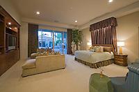 Illuminated bedroom in luxurious residence