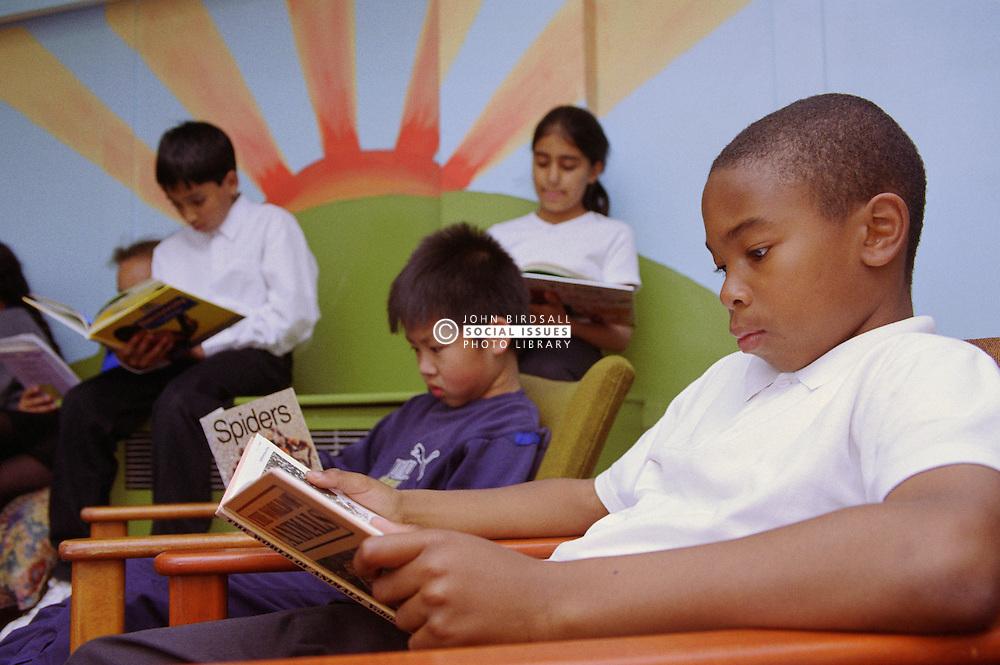 Primary school children reading books in library,