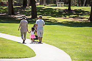 Family Enjoying a Stroll at Ralph B. Clark Regional Park in Buena Park